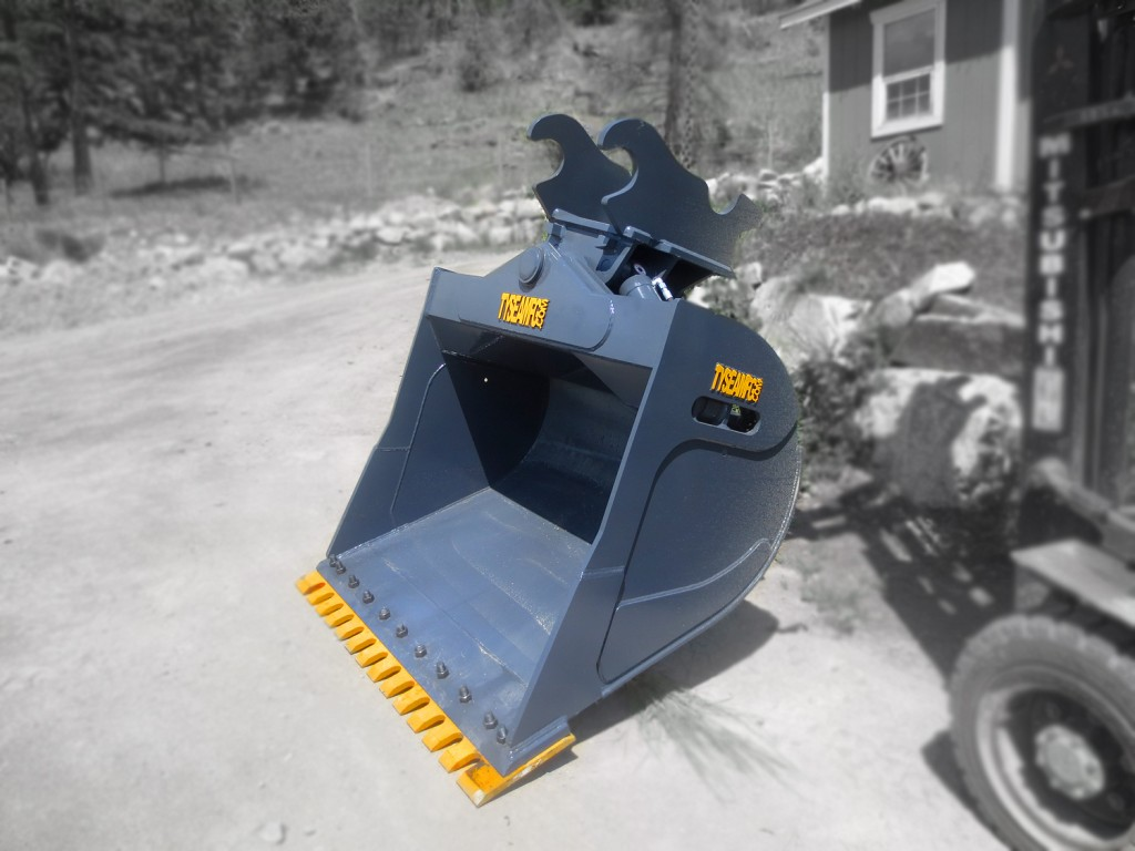 Excavator wrist bucket manufactured by Tysea Mfg.  Complete with replaceable bolt on serrated cutting edge.  Ideal for construction, ditch digging, or digging a slope