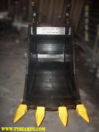 Excavator Frost bucket. An excavator attachment bucket that cuts through ice, rock and solid ground. With ripper teeth and a V- Style configuration.