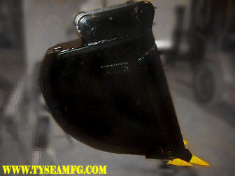 Excavator frost bucket manufactured by Tysea Mfg.  Rips through frozen, compact soil and rock.
