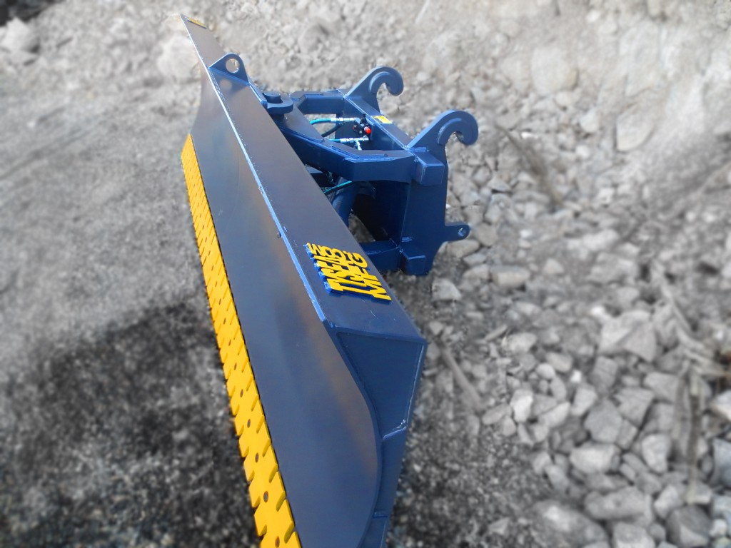 Heavy duty wheel loader snow blade / snow plow / hydraulic angle blade. Manufactured by Tysea mfg inc. Optional bolt on serrated or smooth cutting edge.
