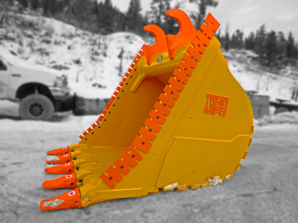 Yellow and orange heavy duty excavator dig bucket manufactured by Tysea Mfg Inc  Complete with serrated cutting edges and replaceable pin on teeth.