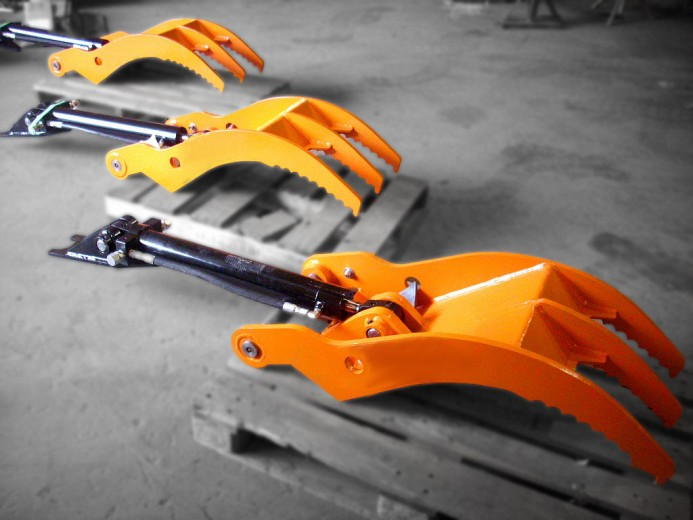 Heavy duty excavator direct link thumbs manufactured by Tysea Mfg.  Hydraulic cylinders manufactured in house by Tysea.