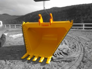 Heavy duty excavator v-bucket.  Complete with bolt on replaceable teeth, and replaceable serrated side cutting edges.  Available in custom configurations, widths and capacities.