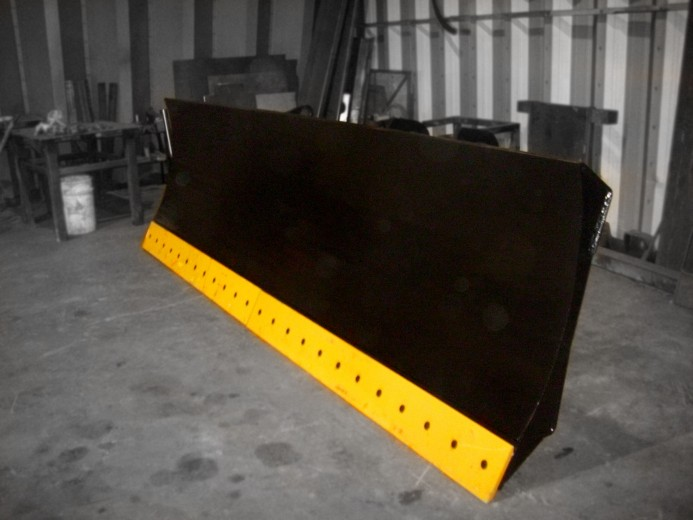 Heavy duty wheel loader snow blade / snow plow / hydraulic angle blade. Manufactured by Tysea mfg inc. Optional bolt on serrated or smooth bolt on cutting edge.