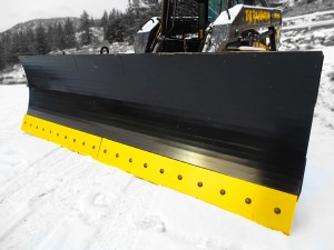 Heavy duty skid steer hydraulic angle / plow / snow blades, black with yellow cutting edge.  Manufactured by Tysea Mfg Inc.