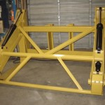 Heavy duty yellow wheel loader pipe pole grapples manufactured by Tysea mfg inc.  For handling and manuevering pipes and poles.