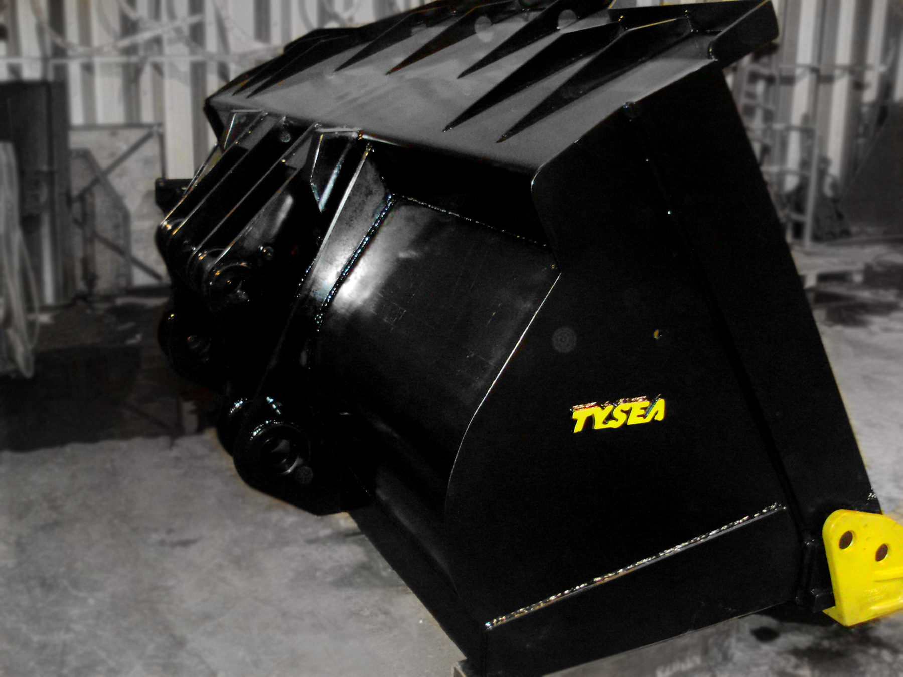 Heavy duty black and yellow wheel loader spade nose digging bucket manufactured by Tysea Mfg