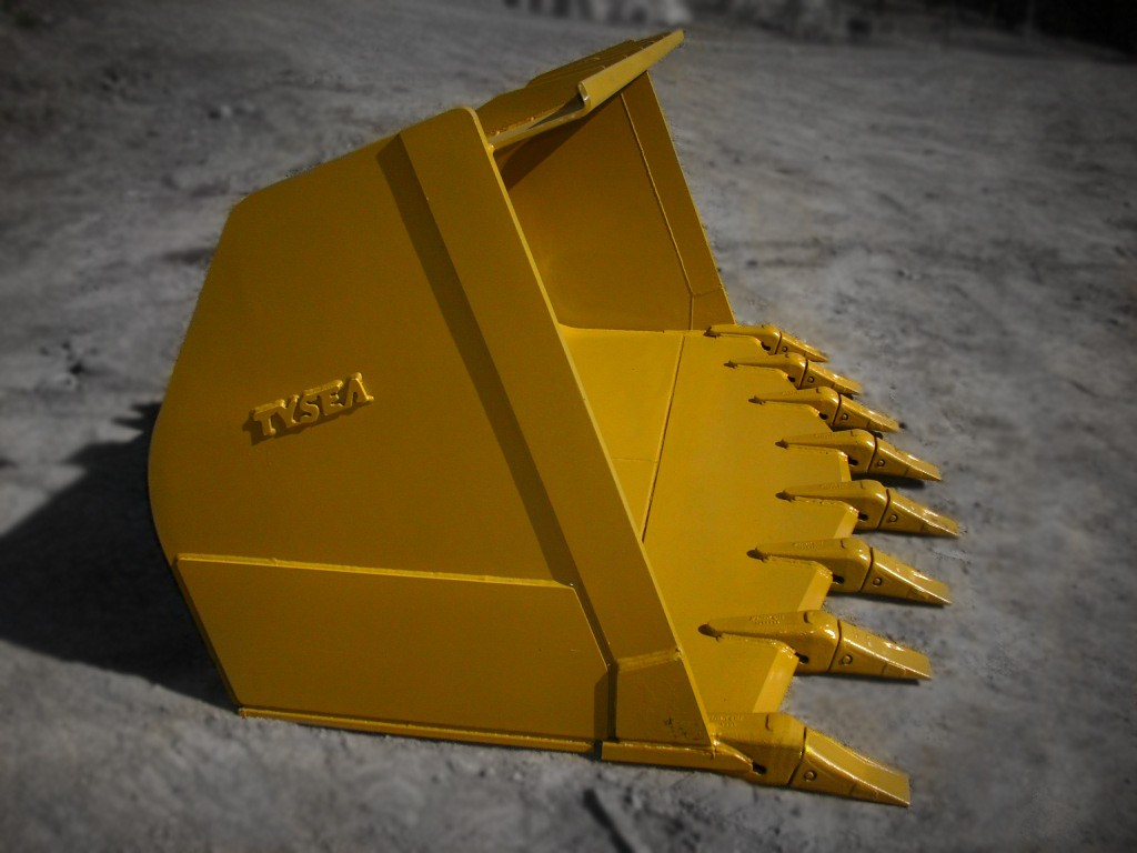 Heavy duty yellow wheel loader spade nose digging bucket manufactured by Tysea Mfg