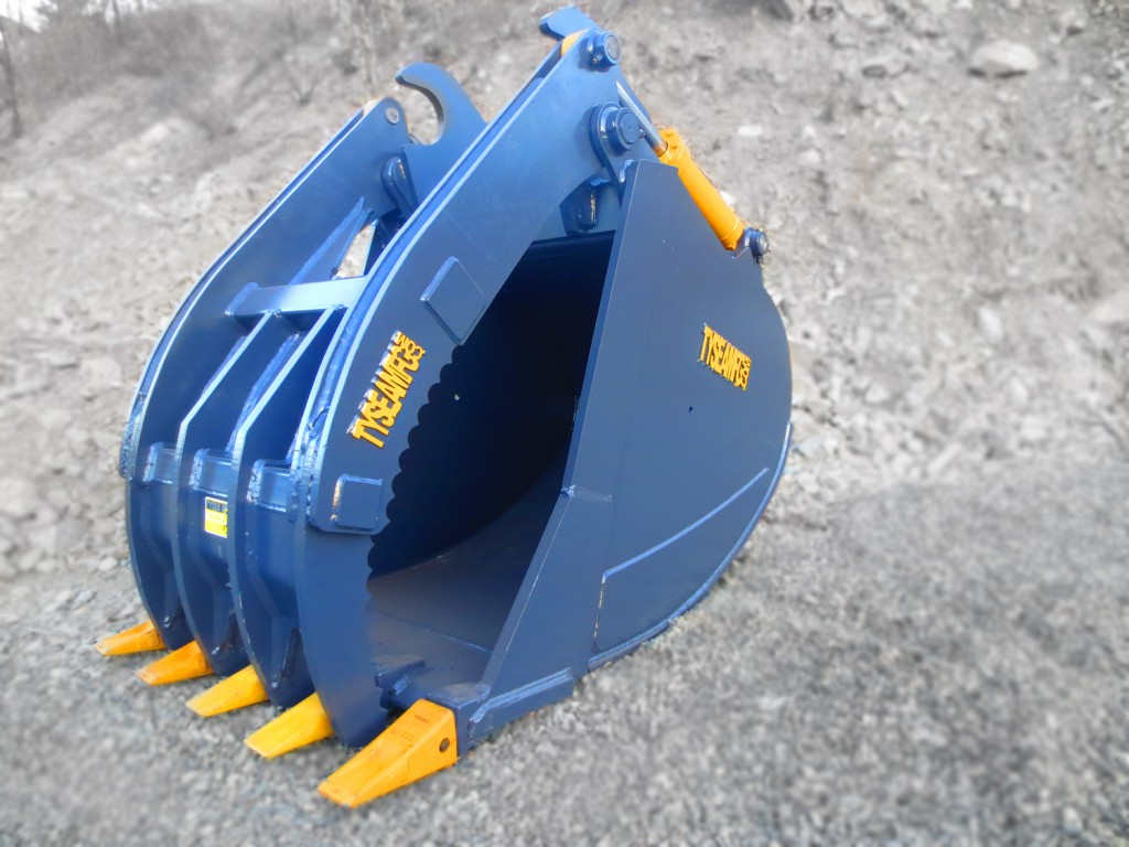 Excavator grapple bucket manufactured by Tysea Mfg.  Hydraulic grapple and dig bucket combination.