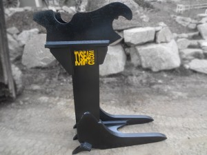 Excavator tree stumper attachment, for foresty and logging. Manufactured by Tysea Mfg.