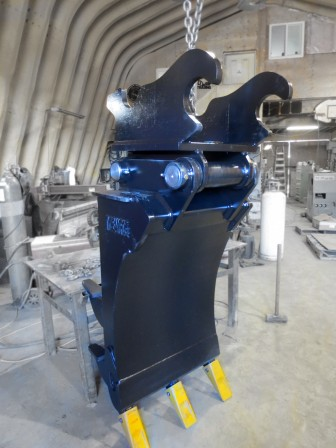 Front profile of excavator mounding rake for tree planting mounds.