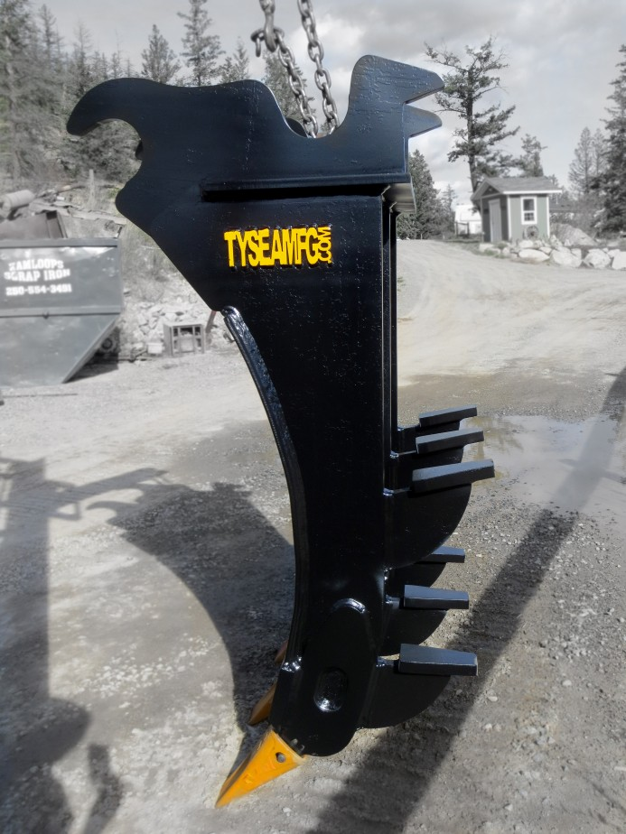 Excavator mounding rake, by Tysea Mfg, complete with dual kickers and replaceable teeth.