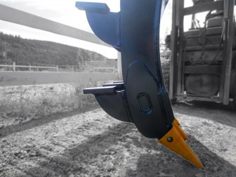 Excavator mounding rake, showing dual kickers and replaceable teeth.  Manufactured by Tysea Mfg.