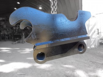 Excavator quick change / quick coupler manufactured for a customers excavator mounding rake.