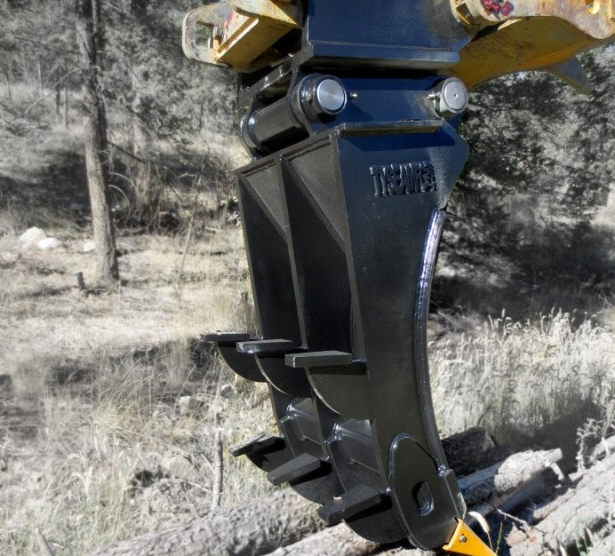 Excavator mounding rake painted black with dual kickers and yellow replaceable teeth.