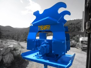 Blue excavator hoe pac compaction plate manufatured by Tysea Mfg.  Optional spike and cup indcluded for post pounding.