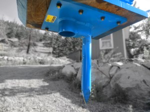 Blue Excavator spike and cup attachment.  Used for fencing and pounding posts.  Utilizes and excavator hoe pac.