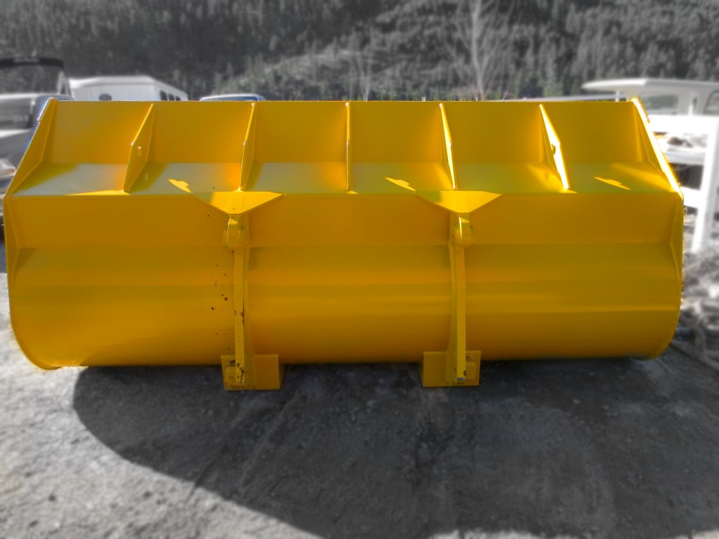 Heavy duty yellow wheel loader clean up bucket manufactured by Tysea Mfg Inc. Rear view dsiplay.