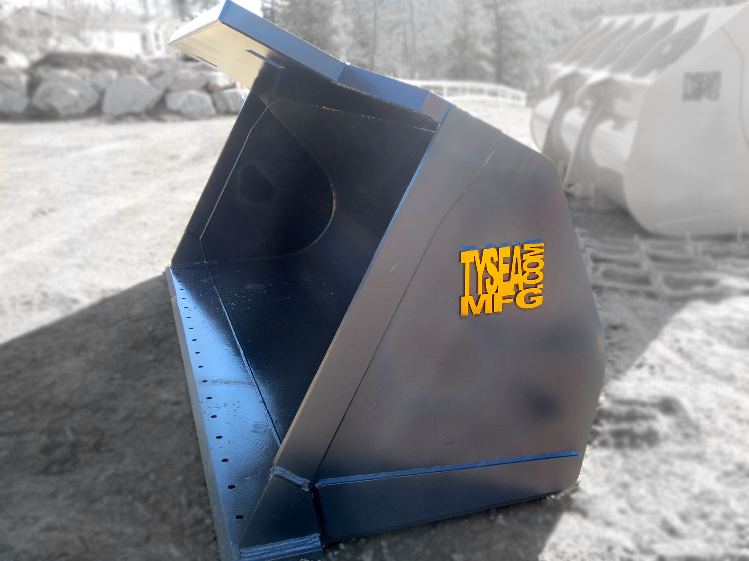 Heavy duty grey wheel loader clean up bucket manufactured by Tysea Mfg Inc