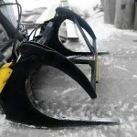 Heavy duty skid steer log grapple, painted black, manufactured by Tysea mfg inc