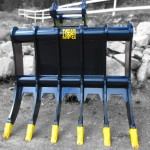 Excavator brush rakes