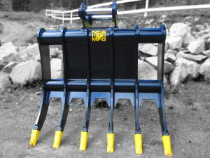 Heavy duty excavator brush rakes.  Complete with custom tine spacing, replaceable pin on teeth and custom lugging.
