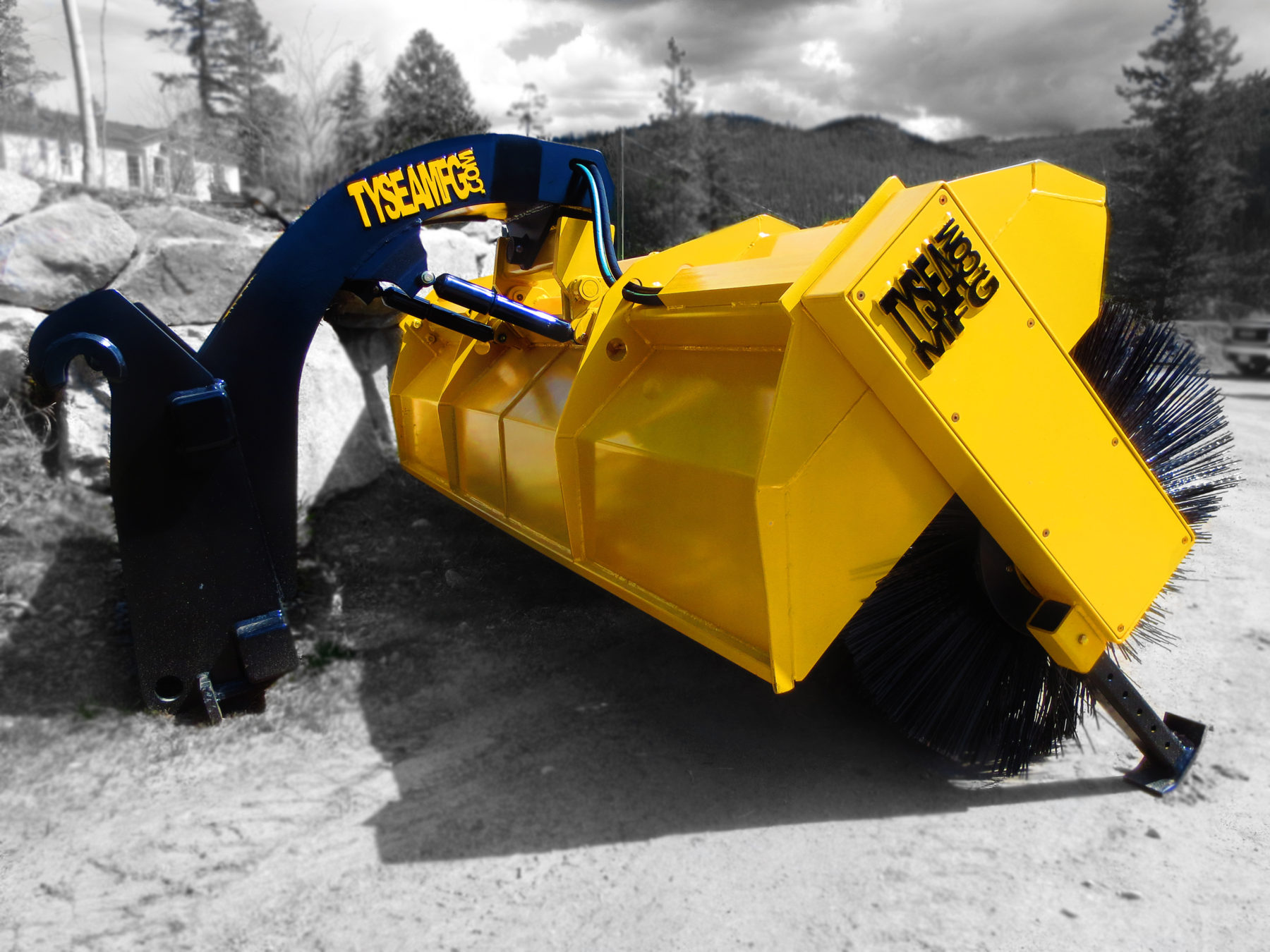 Heavy duty wheel loader hydraulic power sweeper broom, painted yellow with black bristles, manufactured by Tysea Mfg.