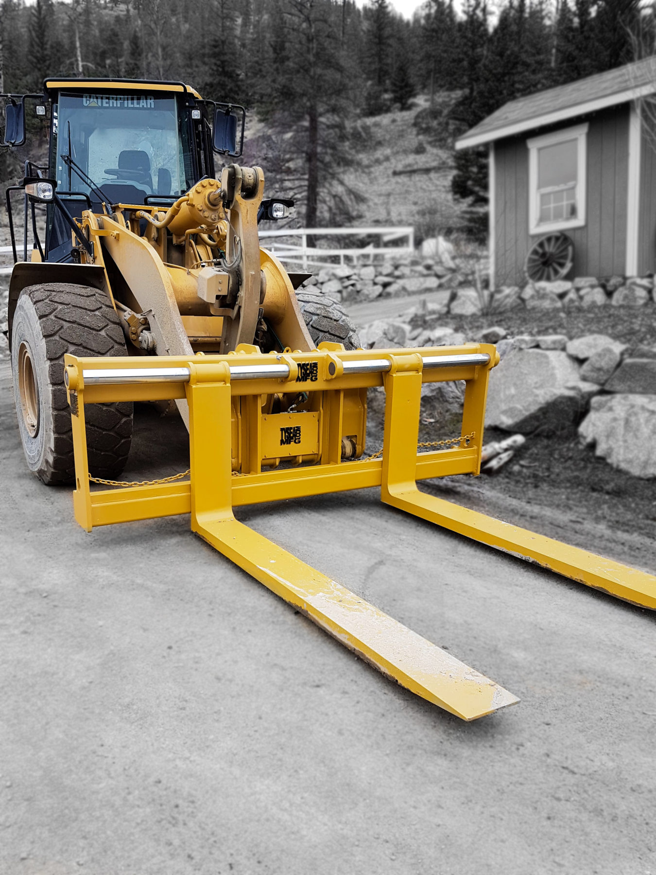 Pallet forks manufactured to customer specs by Tysea Mfg and installed on a wheel loader