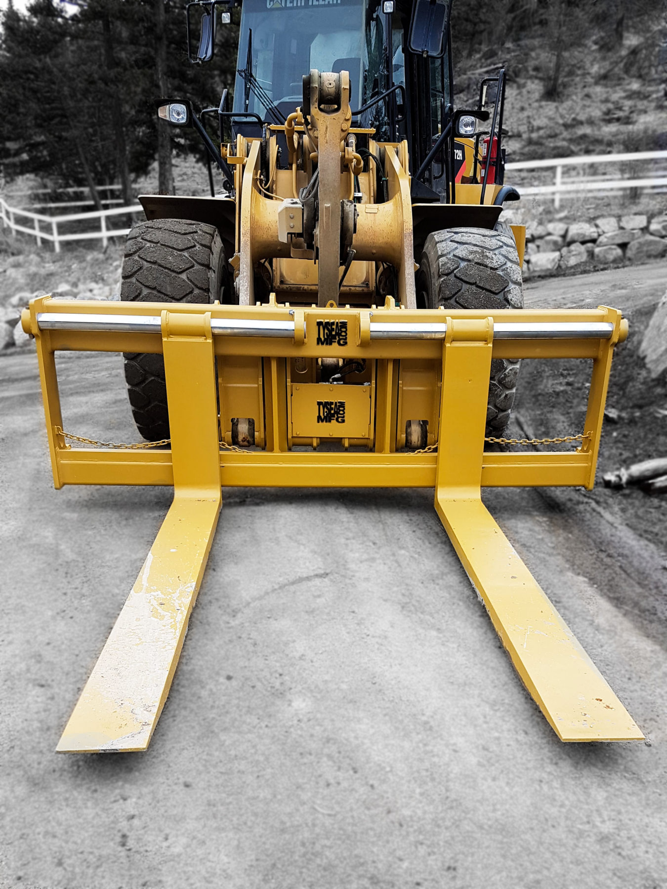 Wheel loader pallet forks manufactured to customer specs by Tysea Mfg and installed on a wheel loader