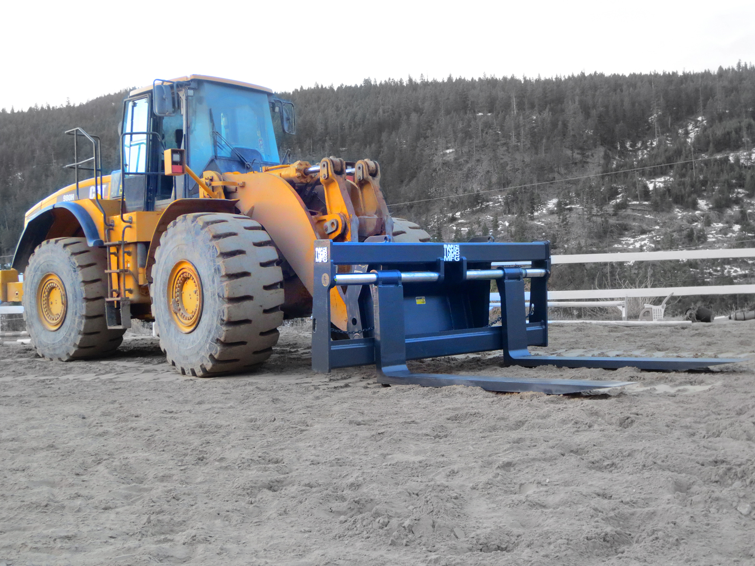 Pallet forks installed on Wheel Loader.  Manufactured to cusotmer specs by Tysea Mfg