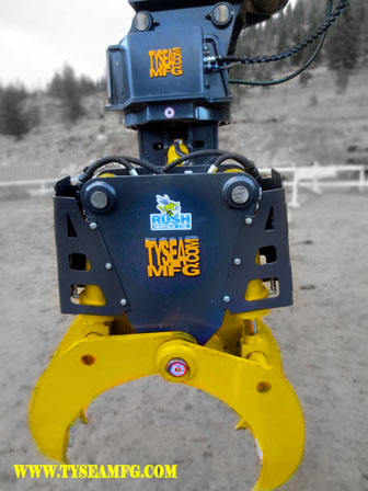 Heavy duty excavator pipe handler attachment manufactured by Tysea Mfg.  The excavator pipe and pole grapple makes handling pipe and utility poles quick and efficient.  Side profile closeup.