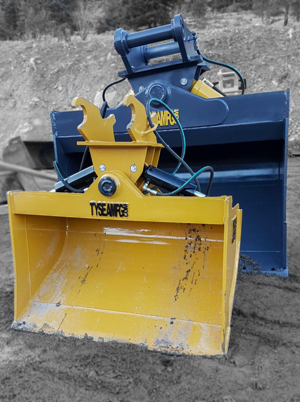 Two excavator wrist buckets manufactured by Tysea Mfg.  Tilting buckets manufactured for a 200 and  80 Cat excavators.