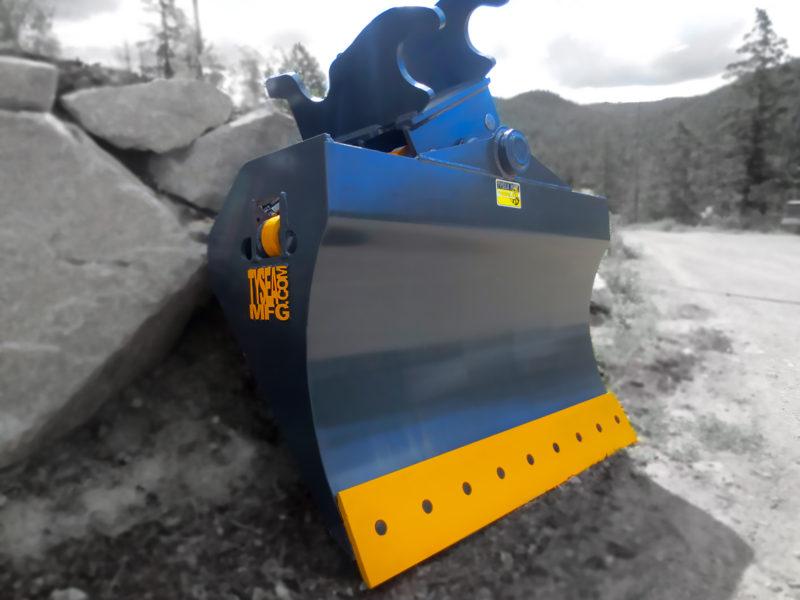 Grey and yellow excavator chuck blade, featuring smooth bolt on cutting edge and tilting design with dual hydraulic cylinders.