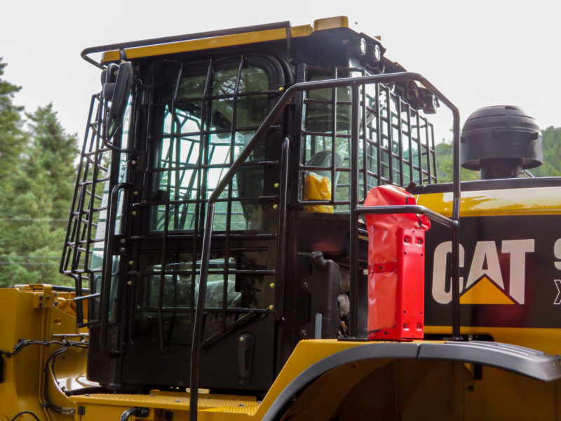 Wheel loader guarding package featuring 360° window protection.  Including side doors, and latching side window guard from additional emergency escape.