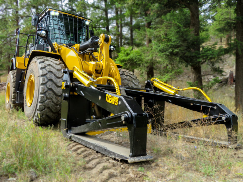 Tysea's wheel loader pipe and pole grapple installed on a 966M CAT loader.  Can be custom manufactured to handle any diameter of wood or steel pipe and poles.