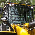 Wheel loader protective guarding for windows